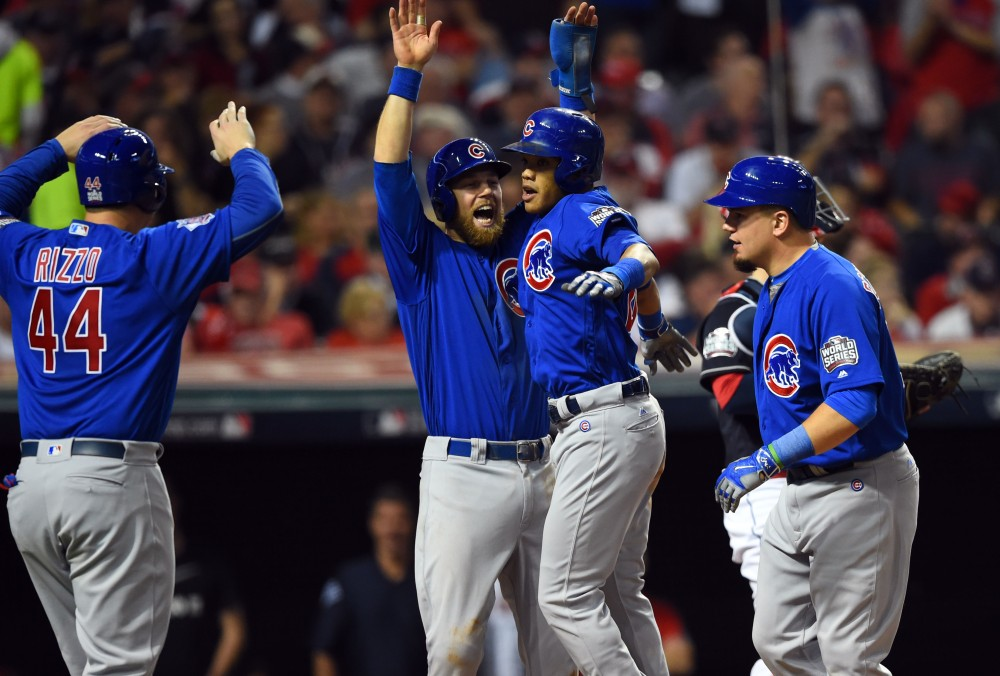 Nov 1, 2016; Cleveland, OH, USA; Chicago Cubs shortstop Addison Russell (27) celebrates with teammates Anthony Rizzo (44) , Kyle Schwarber (12) and Ben Zobrist (18) after hitting a grand slam against the Cleveland Indians in the third inning in game six of the 2016 World Series at Progressive Field. Mandatory Credit: Tommy Gilligan-USA TODAY Sports
